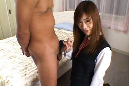 Asian schoolgirl Ami on her knees jerking on a hard shlong. Japanese beauty Ami Hinata