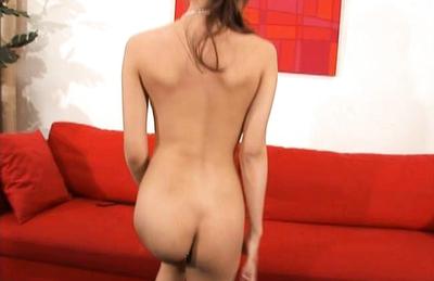 Kirara Asuka Asian demonstrates sexy back and hot behind on red couch. Japanese beauty Kirara Asuka