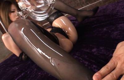Miho Imamura Asian has oil poured over black stockings and thong. Japanese beauty Miho Imamura