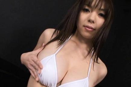 Anmi Hasegawa Sexy Asian doll takes off bra demonstrating big assets. Japanese beauty Anmi Hasegawa