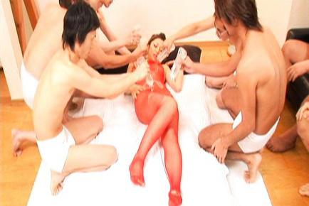Yuna Takizawa Asian has oil covering her body in red fishnet. Japanese beauty Yuna Takizawa