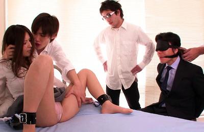 Yuna Shiina Asian has legs spread and tied in front of fuckers. Japanese beauty Yuna Shiina
