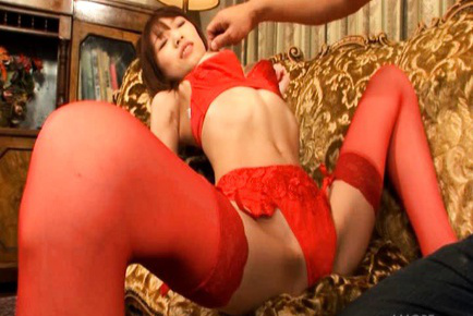 Ibuki Asian nymph on high heels spreads legs in red stockings. Japanese beauty Ibuki