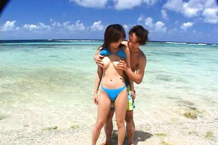 Rin Suzuka Asian has mamillas of big melons licked on ocean shore. Japanese beauty Rin Suzuka