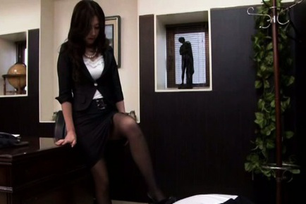 Japanese av model. Japanese AV Model shows hot ass in stockings on boss chair