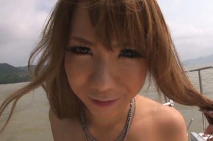 Asuka Hoshino Asian touches woody of her round cans on the yacht. Japanese beauty Asuka Hoshino