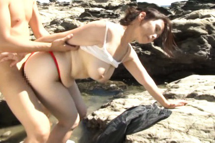 Yuuko kuremachi. Yuuko Kuremachi with cloth between arse cheeks sucks penish on rocks
