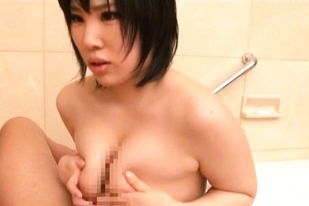 Mii Takeuchi Asian has cans squeezed and fondles erection between them. Japanese beauty Mii Takeuchi