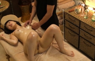 Japanese av model. Japanese AV Model gets oil on curves and clit rubbed at massage