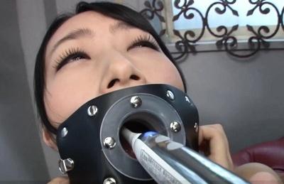 Ami Kumono Asian has teeth brushed by force through machine. Japanese beauty Ami Kumono