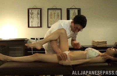 Amateur Asian dame is touched on body by masseurs in hot position