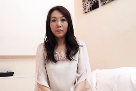 Amateur Asian dame in elegant blouse strokes phallus with passion. Japanese beauty Amateur
